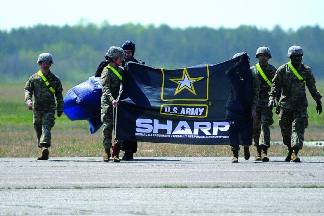 Detailed advanced individual training Soldiers walk across the tarmac after retrieving the SHARP flag that flew attached to an Aerial Delivery and Field Services freefall parachutist April 11 at Fort Pickett's Blackstone Army Airfield. The freefall operation was part of the Jumping for SHARP event meant to help attendees better grasp the Army's Sexual Harassment/Assault Response and Prevention program. The Army hosted its annual Sexual Assault Awareness and Prevention Month Recognition Ceremony in the Hall of Heroes at the Pentagon in Arlington, Va., April 23, 2019.