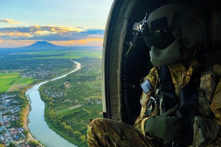A Soldier who serves as crew chief with Charlie Company, 3rd General Support Aviation Battalion, 25th Combat Aviation Brigade, studies terrain aboard a UH-60 Blackhawk aircraft as part of a flight survey during Exercise Balikatan 2019 near Mount Pinatubo, Fort Magsaysay, Philippines, April 1, 2019. Exercise Balikatan, in its 35th iteration, is an annual U.S.-Philippine military training focused on a variety of missions, including humanitarian assistance and disaster relief, counter-terrorism, and other combined military operations held from April 1 to April 12.