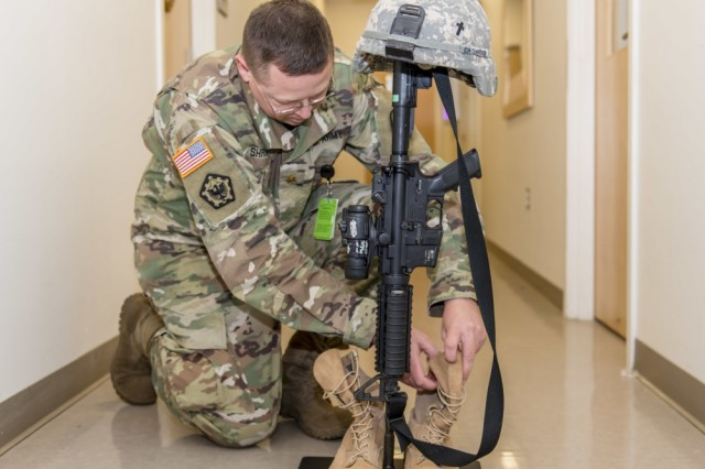 Chaplain Maj. Andrew Shriver (pictured here) of the Combat Capabilities Development Command Soldier Center, or CCDC SC, worked with the CCDC SC's Fabrication Team, part of the Expeditionary Maneuver Support Directorate, or EMSD, to develop the Expeditionary Memorial Rifle Stand to meet the memorial needs of modern Soldiers. The resulting prototype/product is a simple, fast solution to an important need. The lightweight, easy-to-move Expeditionary Memorial Rifle Stand consists of a highly functional and efficiently designed lightweight metal rod and plate to which Soldiers can add a helmet, dog tags, a pair of boots and a rifle (items that they already have). Since the Soldiers can easily take the memorial stand with them when they move, it leaves no footprint. The stand gives Soldiers a concrete way to take the time to grieve, which can be key to healing and resiliency.