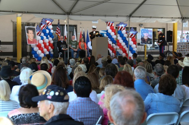 Hundreds gathered at a Orange County post office for a dedication ceremony to Spc. Trevor A. Win'E April 24 at Orange County, California. Almost 15 years ago, Spc. Trevor A. Win'E, 593rd Expeditionary Sustainment Command, died from injuries after his convoy encountered an improvised explosive devise in Iraq May 1, 2004 - the day of his second anniversary of joining the Army.