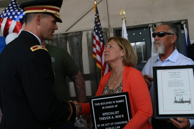 Col. Mark Vandersteen, 593rd Expeditionary Sustainment Command, speaks to Debi Win'E. Members of the 593rd ESC traveled to Orange County, California to honor Spc. Win'E, who was assigned to 24th Composite Supply Company at the time of his death in Iraq almost 15 years ago.
