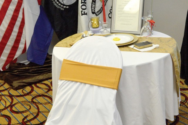 FORT CARSON, Colo. - A table set up at the Gold Star Spouses Luncheon, hosted by Fort Carson's Survivor Outreach Services at the MCM Elegante Suites hotel April 18, 2019, symbolizes service members who are prisoners of war or missing in action. (Photo by Scott Prater)