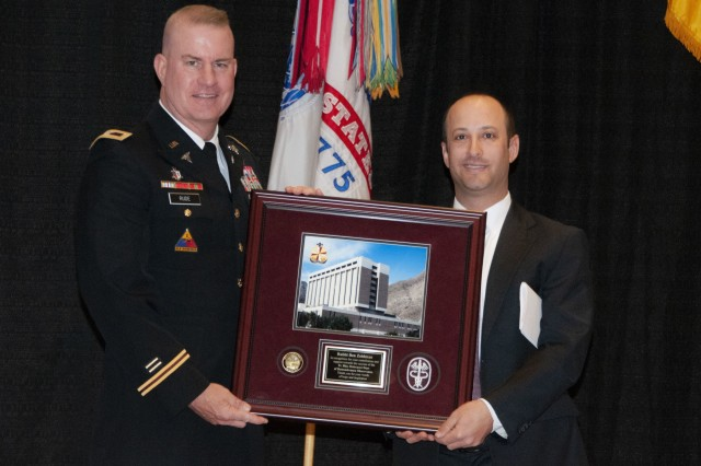 Col. Erik Rude, commander, William Beaumont Army Medical Center, presents a token of appreciation to Rabbi Ben Zeidman, of Temple Mount Sinai in El Paso, who was this year's guest speaker during the Fort Bliss Days of Remembrance observance. The Equal Opportunity team at William Beaumont Army Medical Center hosted the observance at the Centennial Banquet and Conference Center, April 17.