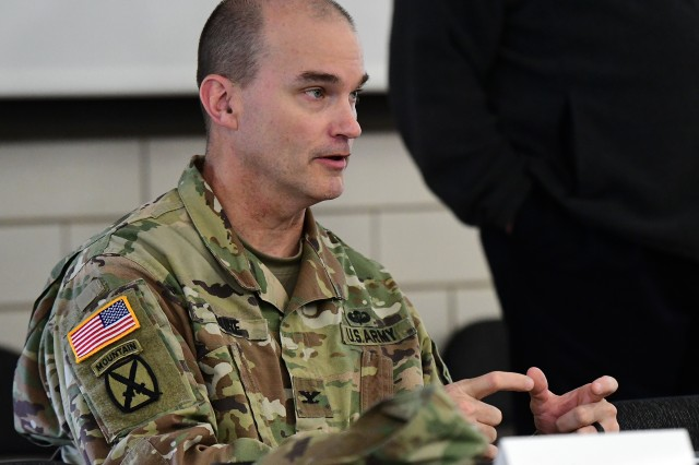 Col. Pat Kaune, Fort Knox garrison commander, injects some personal knowledge into the table top discussion April 26, 2019, as members discuss the role of an emergency operations center during a crisis.