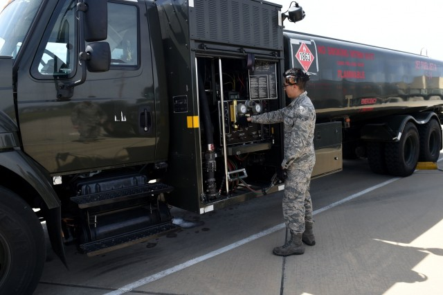 Airman 1st Class Kevin Molina, 627th Logistics Readiness Squadron, fuels technician, adjusts the control panel on a fuel truck on March Air Reserve Base in Calif., April 1. The fuel trucks used by the 627th LRS can pump up to 600 gallons of fuel per minute.