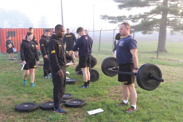 Sgt. 1st Class Tony Husbands, an instructor with the ACFT Mobile Training Team, grades Staff Sgt. Zachary Graf, Headquarters Headquarters Company, 1st Battalion, 187th Infantry Regiment, 101st Airborne Division (Air Assault), during the three-lift, max-deadlift event at Fryar Stadium, Fort Campbell, Ky., April 9. Performing this deadlift simulates lifting a litter in a deployed environment, according to the United States Army Physical Fitness School at Fort Jackson, S.C., which sent a Mobile Training Team to Fort Campbell, April 5-11, to train Screaming Eagle Soldiers how to perform and conduct an ACFT. (U.S. Army Photo by Spc. Andrew Jo)