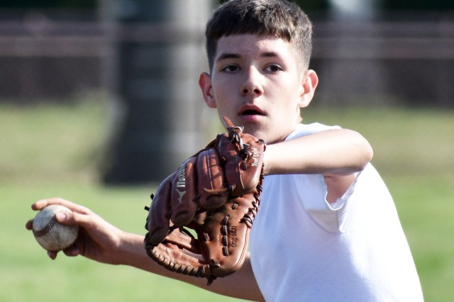 Carter Meissner, a member of the Zama Middle High School baseball team, practices on Camp Zama April 25.