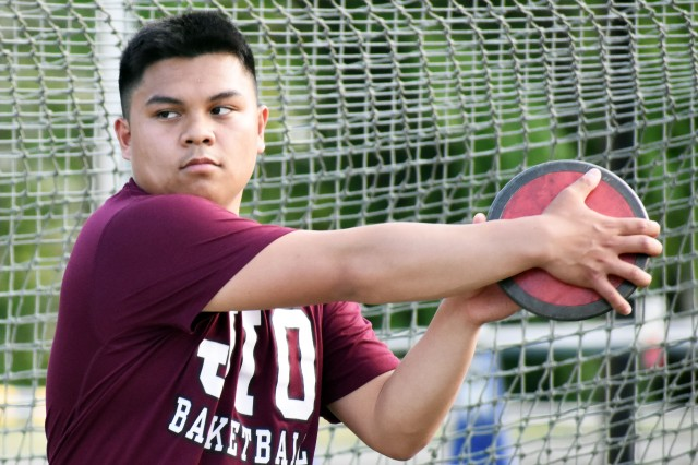 Jarred Sampayan, a member of the Zama Middle High School track and field team, practices throwing the discus at the school April 25.