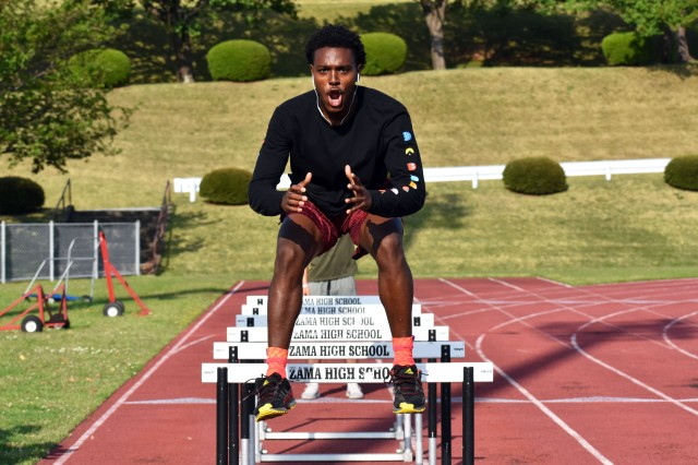 Chandler Platt, a member of the Zama Middle High School track and field team, practices hurdling at the school April 25.