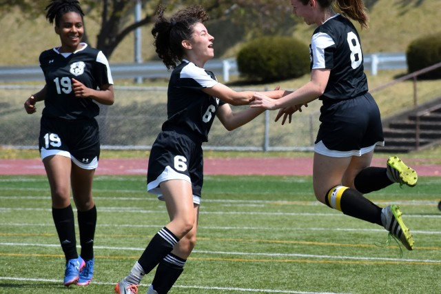 Siobhan Grabski, right, celebrates scoring a goal with Meridean Duarte, center, and Chloe Sterling, left, during a game against Yokota High School from Yokota Air Base, Japan, in the Pacific East Soccer Tournament 2019 semi-final game at Camp Zama April 20.
