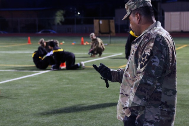 Master Sgt. Gene R. Ruiz, El Paso, Texas native, chemical, biological, radiological, nuclear noncommissioned officer in charge, 2nd Infantry Division/ROK-U.S. Combined Division, administers the sit-up event during the Army Physical Fitness Test at the 2019 2ID Best Warrior Competition, Camp Hovey, Republic of Korea, April 15.  The top officer, warrant officer, noncommissioned officer, junior enlisted Soldier, and Korean Augmentation to the U.S. Army (KATUSA) within the division will proceed onto the Eighth Army BWC, May 11.(U.S. Army photo by Sgt. Kayla Hocker, 20th Public Affairs Detachment)