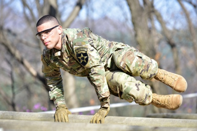 Pfc. Tyler Rieker, Lancaster, Pennsylvania native, signal intelligence analyst, Headquarters and Headquarters Battalion, 2nd Infantry Division/ROK-U.S. Combined Division, negotiates an obstacle course during the 2019 2ID Best Warrior Competition at Camp Hovey, Republic of Korea, April 15. The obstacle course tested the Soldiers' strength, endurance, and drive to never quit. The best in the division will advance to the Eighth Army-Korea BWC, May 11.