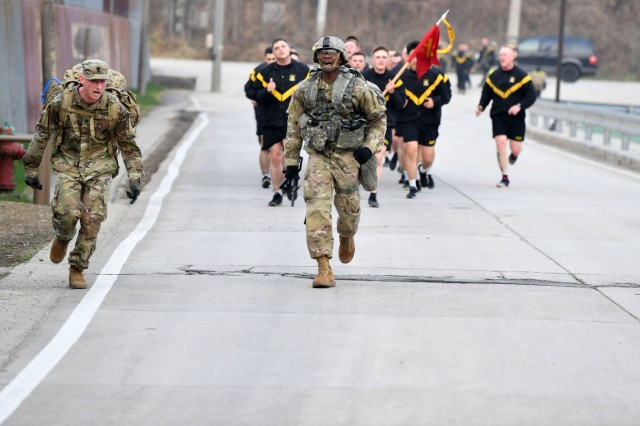 CAMP HOVEY, Republic of Korea -- 1st Lt. Stephen Adjei, Worcester, Massachusetts native, automated logistical officer, 210th Field Artillery Brigade, 2nd Infantry Division/ROK-U.S. Combined Division, powers through the final stretch of the eight-mile ruck march, the final event of the 2019 2ID Best Warrior Competition, April 19. The grueling six-day competition comes to a close with a ceremony at Camp Casey Theater where the winner of each category (officer, warrant officer, NCO, enlisted Soldier, and KATUSA) is announced.