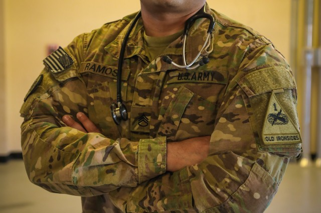 "CAMP HUMPHREYS, Republic of Korea - Sgt. Juan Ramos, platoon sergeant and Phoenix, Arizona native, 4th Battalion, 6th Infantry Regiment ""Regulars"", 3rd Armored Brigade Combat Team, 1st Armored Division (Rotational), called 9-1-1 and administered cardiopulmonary resuscitation to help save Cpl. Michael Decoeur, Crawfordville, Florida, combat medic specialist, 4-6 Inf. Regt. Decoeur had a heart attack while preparing for work. He was medically evacuated to Tripler Hospital in Honolulu, Hawaii to receive proper care and rehabilitation. (U.S. Army photo by Sgt. Alon J. Humphrey, 3rd ABCT, 1st AD Public Affairs Office)"