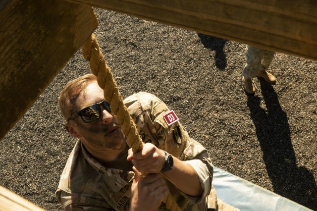 Sgt. Zachary Dobbs, with the 261st Multi-Functional Medical Battalion, 44th Medical Brigade, climbs a rope during the Operation Dragon Medic Strong competition at the Deglopper Air Assault Obstacle Course, Fort Bragg, N.C., April 16, 2019. Competitors used various movement techniques to get to the top of the rope. (U.S. Army Photo by Spc. ShaTyra Reed / 22nd Mobile Public Affairs Detachment)