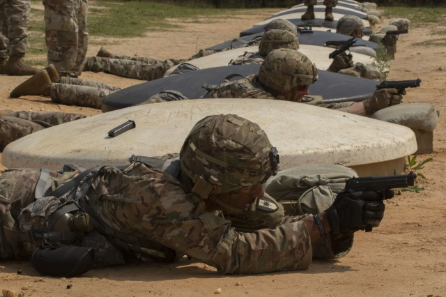 Members of Team A, Headquarters and Headquarters Company, 44th Medical Brigade, shoots a M9 pistol at targets in the prone position at the range qualification event during the Operation Dragon Medic Strong competition April 17, 2019 at Fort Bragg, N.C. The competition tested each Soldier's ability to complete a series of events that tested them physically, mentally and spiritually. (U.S. Army photo by Spc. ShaTyra Reed / 22nd Mobile Public Affairs Detachment)