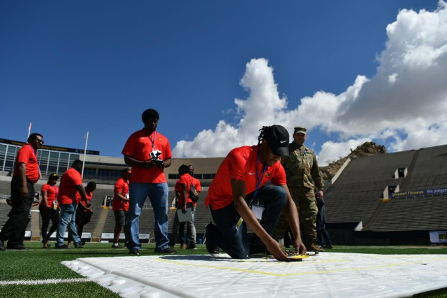 Undergraduate students from Grambling State University prepare their unmanned aerial vehicle for a flight demonstration as part of the U.S. Army's inaugural HBCU/MI Design Competition held at the University of Texas at El Paso's Sun Bowl Stadium April 23-24, 2019. The competition, led by the U.S. Army Combat Capabilities Development Command, challenged 11 undergraduate student teams from historically black colleges and universities and other minority serving institutions (HBCUs/MIs) to develop solutions to real-world technical challenges faced by U.S. Army researchers in the area of unmanned aerial vehicles, commonly called drones.