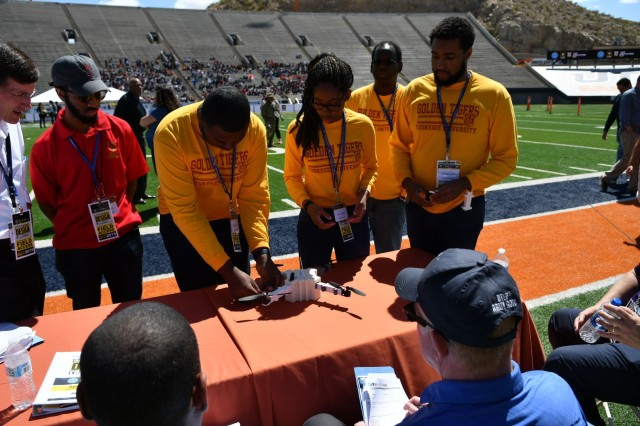 Unable to fly their unmanned aerial vehicle due to technical difficulties, the team of undergraduate students from Tuskegee University explain the design of their UAV to the judging panel during the U.S. Army's inaugural HBCU/MI Design Competition held at the University of Texas at El Paso's Sun Bowl Stadium April 23-24, 2019. The competition, led by the U.S. Army Combat Capabilities Development Command, challenged 11 undergraduate student teams from historically black colleges and universities and other minority serving institutions (HBCUs/MIs) to develop solutions to real-world technical challenges faced by U.S. Army researchers in the area of unmanned aerial vehicles, commonly called drones.