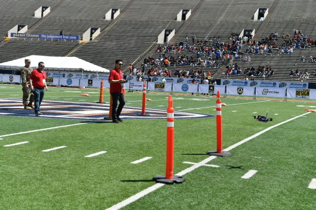 An undergraduate student from the University of Illinois Chicago maneuvers a  small unmanned aerial vehicle through the course during the U.S. Army's inaugural HBCU/MI Design Competition held at the University of Texas at El Paso's Sun Bowl Stadium April 23-24, 2019.The competition, led by the U.S. Army Combat Capabilities Development Command, challenged 11 undergraduate student teams from historically black colleges and universities and other minority serving institutions (HBCUs/MIs) to develop solutions to real-world technical challenges faced by U.S. Army researchers in the area of unmanned aerial vehicles, commonly called drones.