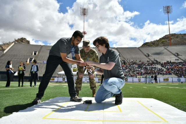 Undergraduate students from the University of Texas at Arlington prepare their unmanned aerial vehicle for a flight demonstration as part of the U.S. Army's inaugural HBCU/MI Design Competition held at the University of Texas at El Paso's Sun Bowl Stadium April 23-24, 2019.The competition, led by the U.S. Army Combat Capabilities Development Command, challenged 11 undergraduate student teams from historically black colleges and universities and other minority serving institutions (HBCUs/MIs) to develop solutions to real-world technical challenges faced by U.S. Army researchers in the area of unmanned aerial vehicles, commonly called drones.