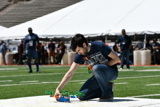 An undergraduate student from the University of Texas at San Antonio inspects his team's unmanned aerial vehicle during a flight demonstration as part of the U.S. Army's inaugural HBCU/MI Design Competition held at the University of Texas at El Paso's Sun Bowl Stadium April 23-24, 2019.The competition, led by the U.S. Army Combat Capabilities Development Command, challenged 11 undergraduate student teams from historically black colleges and universities and other minority serving institutions (HBCUs/MIs) to develop solutions to real-world technical challenges faced by U.S. Army researchers in the area of unmanned aerial vehicles, commonly called drones.