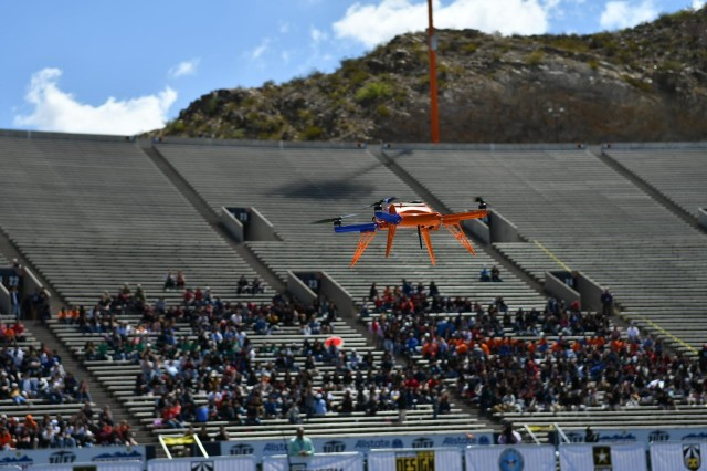 An unmanned aerial vehicle, flown by a team of undergraduate students from the University of Texas at El Paso, maneuvers the course during the U.S. Army's inaugural HBCU/MI Design Competition held at the University of Texas at El Paso's Sun Bowl Stadium April 23-24, 2019, as local high school students watch from the stands. Each team had ten minutes to complete a series of tasks with the UAV they designed and built for the competition.The competition, led by the U.S. Army Combat Capabilities Development Command, challenged 11 undergraduate student teams from historically black colleges and universities and other minority serving institutions (HBCUs/MIs) to develop solutions to real-world technical challenges faced by U.S. Army researchers in the area of unmanned aerial vehicles, commonly called drones.