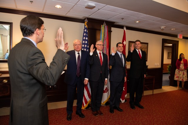 The Honorable Dr. Mark T. Esper, far left, congratulates, from left to right, Steven Herman, Michael Flanagan, Jim Bland, and Eric Ahlness on appointment as Civilian Aides to the Secretary of the Army.