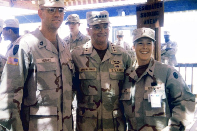 Frank Hughes (left) interacts with retired, former Chairman of the Joint Chiefs of Staff Gen. John Shalikashvili (center) and 2nd Lt. Shannon Lutz (right) during his deployment as detachment first sergeant for an air defense mission in Riyahd, Saudi Arabia in 1996. (U.S. Army photo/Releasable)