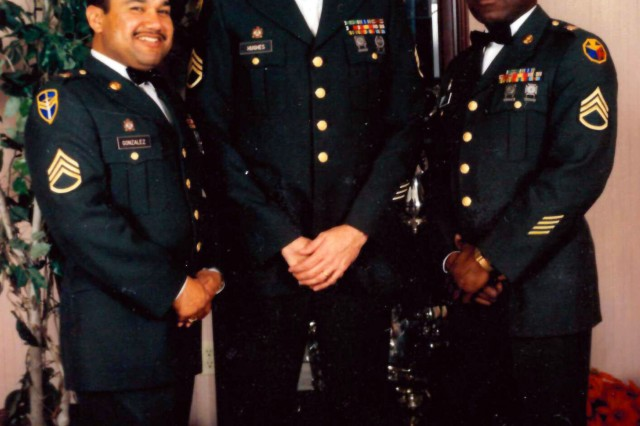 Frank Hughes (center) enjoys a night out with fellow soldiers during the Noncommissioned Officer's Club Christmas Dining Out event at Fort Irwin, California, in October 1991. (U.S. Army photo/Releasable)