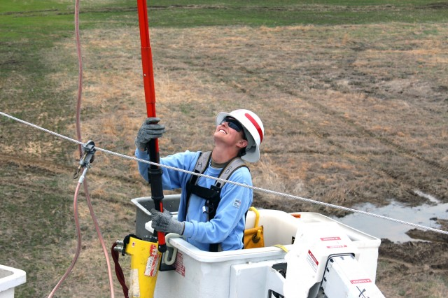 A Power Distribution Specialist with Prime Power tests power lines for electrical charge during a field training exercise in Fort AP Hill. The 249th Engineer Battalion, also known as Prime Power, is a versatile power generation battalion assigned to the U.S. Army Corps of Engineers that is charged with the rapid provision of Army generators to support worldwide requirements.