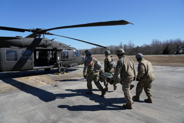 Soldiers with the 249th Engineer Battalion board a Black Hawk helicopter during a medevac exercise at Fort AP Hill, Virginia.  The medevac exercise was part of a larger field training exercise to actively prepare the battalion members to successfully fulfill 249th Engineer Battalion missions. The 249th Engineer Battalion is a versatile power generation battalion assigned to the U.S. Army Corps of Engineers that is charged with the rapid provision of Army generators to support worldwide requirements.