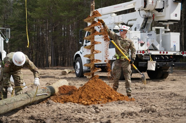 A 249th Engineer Battalion Power Distribution Specialists supervises the drill digging for the installment of a power utility pole during a field training exercise at Fort AP Hill, Virginia. Also known as Prime Power, the 249th Engineer Battalion is a versatile power generation battalion assigned to the U.S. Army Corps of Engineers that is charged with the rapid provision of Army generators to support worldwide requirements. The soldiers and reservists assigned to this battalion complete a mission unlike anything found elsewhere in the Army by providing commercial-level power to military units and federal relief organizations.