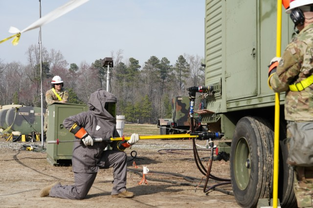 A 249th Engineer Battalion Power Production Specialist performs generator maintenance during a field training exercise at Fort AP Hill, Virginia. Power Production Specialists are trained to supervise, operate, install and perform sustainment-level maintenance on electric power plants. The field training exercise allowed the specialists to train in different environments while getting an electric-distribution system up and running using 840-kilowatt generators and higher, which could power a small town or base.