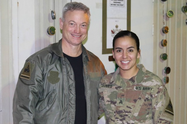 Actor Gary Sinise conducts a meet and greet with Sgt. Von Marie Donato, a public affairs non-commissioned officer assigned to Combined Joint Forces Land Component Command - Operation Inherent Resolve and 1st Armored Division, as he visits service members in Baghdad, Iraq, Dec. 20, 2017. The visit was part of a United Service Organization entertainment tour to promote morale and support military members. (U.S. Army photo by Spc. Avery Howard)