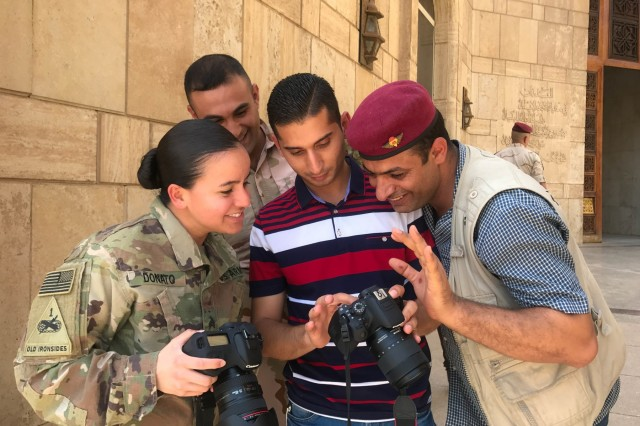 Sgt. Von Marie Donato, a public affairs non-commissioned officer assigned to Combined Joint Forces Land Component Command - Operation Inherent Resolve and 1st Armored Division, provides media and photography training to Iraqi security forces and media personnel at the Baghdad Operations Center in Baghdad, Iraq, Aug. 21, 2017. CJFLCC-OIR is a Coalition of 23 regional and international nations which have joined together to enable partnered forces to defeat ISIS in Iraq and restore stability and security. (Photo by British Army Maj. Benjamin Johnson)