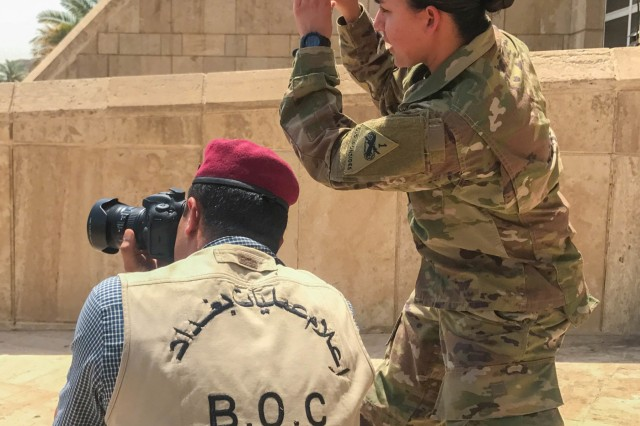 Sgt. Von Marie Donato, a public affairs non-commissioned officer assigned to Combined Joint Forces Land Component Command - Operation Inherent Resolve and 1st Armored Division, provides media and photography training to an Iraqi security forces member at the Baghdad Operations Center in Baghdad, Iraq, Aug. 21, 2017. CJFLCC-OIR is a Coalition of 23 regional and international nations which have joined together to enable partnered forces to defeat ISIS in Iraq and restore stability and security. (Photo by British Army Maj. Benjamin Johnson)