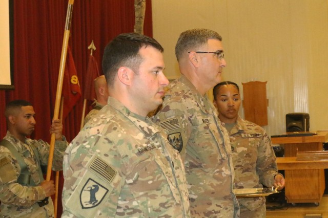 Lt. Col. Leo Karanikolas, 420th Transportation Battalion, prepares to receive the Meritorious Service Medal from Brig. Gen. Clint E. Walker, commanding general of 184th Sustainment Command, during a transfer of authority ceremony at Camp Arifjan, Kuwait, April 25, 2019. The Sherman Oaks, Calif. based 420th officially transfers authority of the theater movement control battalion mission to the Manhattan, Kan. based 450th Transportation Battalion on April 28, 2019.