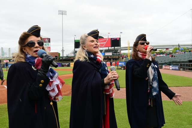 Members of the Ladies for Liberty perform traditional military numbers prior to the start of the game. They came out during the 7th inning stretch to perform another number for the crowd.