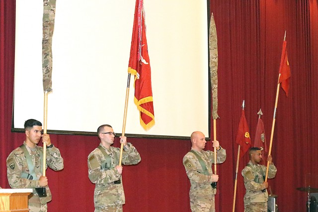 The 420th Transportation Battalion's colors are cased and 450th Transportation Battalion's colors are uncased, symbolizing the transfer of authority at Camp Arifjan, Kuwait, April 25, 2019. The Sherman Oaks, Calif. based 420th officially transfers authority of the theater movement control battalion mission to the Manhattan, Kan. based 450th Transportation Battalion on April 28, 2019.