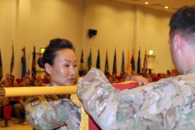 1st Sgt. Sun Lee, 420th Transportation Battalion, prepares to case the battalion's colors during their transfer of authority ceremony at Camp Arifjan, Kuwait, April 25, 2019. The Sherman Oaks, Calif. based 420th officially transfers authority of the theater movement control battalion mission to the Manhattan, Kan. based 450th Transportation Battalion on April 28, 2019.