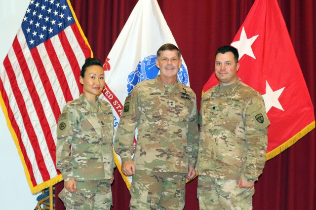 "1st Sgt. Sun Lee, 420th Transportation Battalion, Maj. Gen. Flem B. ""Donnie"" Walker, commanding general of 1st Theater Sustainment Command, and Lt. Col. Leo Karanikolas, 420th Transportation Battalion,  at Camp Arifjan, Kuwait, April 25, 2019."
