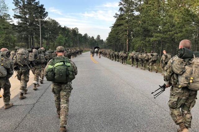 U.S. Army Rangers from 3rd Battalion, 75th Ranger Regiment and the Ranger Recruiting Liaison office participate in a 12-mile ruck march with trainees of infantry One-Station Unit Training (OSUT) at Fort Benning, Ga., April 18, 2019. In collaboration with OSUT leadership and the Ranger Recruiting Liaison office, the Rangers are joining OSUT field exercises and fitness events to introduce trainees to the Ranger ethos, build camaraderie and answer questions about the Regiment. Following infantry OSUT, select trainees are on path to attend the Ranger Assessment and Selection Program and vie for an opportunity to join the Ranger Regiment. (Photo courtesy of Ranger Recruiting Liaison office, Fort Benning)