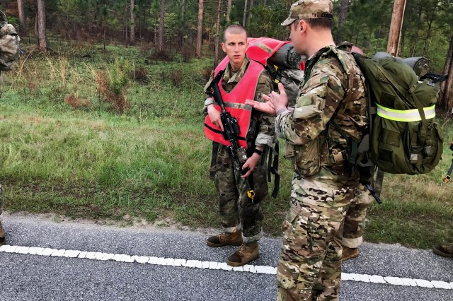 A U.S. Army Ranger from 3rd Battalion, 75th Ranger Regiment speaks with a Soldier-in-training during a 12-mile ruck march at infantry One-Station Unit Training (OSUT), Fort Benning, Ga., April 18, 2019. In collaboration with OSUT leadership and the Ranger Recruiting Liaison office, the Rangers are joining OSUT field exercises and fitness events to introduce trainees to the Ranger ethos, build camaraderie and answer questions about the Regiment. Following infantry OSUT, select trainees are on path to attend the Ranger Assessment and Selection Program and vie for an opportunity to join the Ranger Regiment. (Photo courtesy of Ranger Recruiting Liaison office, Fort Benning)