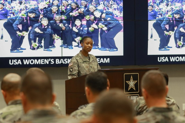 1st Sgt. Teneka S. Oliver, senior enlisted advisor for Intelligence and Sustainment Company, Headquarters and Headquarters Battalion, U.S. Army Central, introduces the guest speaker at the Women's History Month observance ceremony at USARCENT headquarters on Shaw Air Force Base, S.C., March 13, 2019. (U.S. Army photo by Sgt. Von Marie Donato)