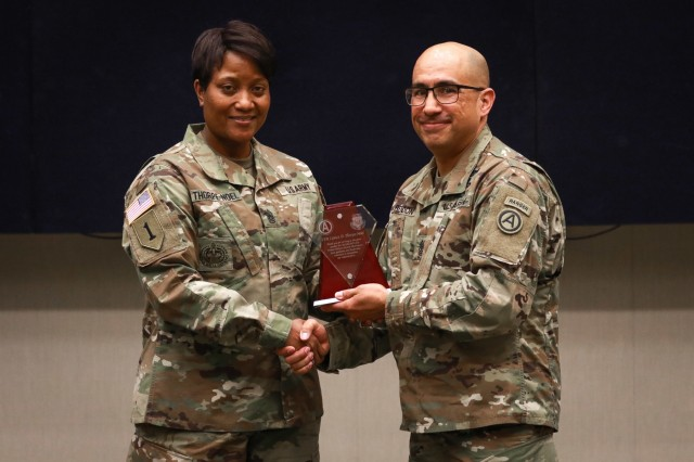 Command Sgt. Maj. Lynice D. Thorpe-Noel, the senior enlisted advisor for U.S. Army Human Resources Command, receives an appreciation gift from Sgt. Maj. Roger Rendon, the human resources senior enlisted advisor, U.S. Army Central, during the Women's History Month observance ceremony at USARCENT headquarters on Shaw Air Force Base, S.C., March 13, 2019. (U.S. Army photo by Sgt. Von Marie Donato)