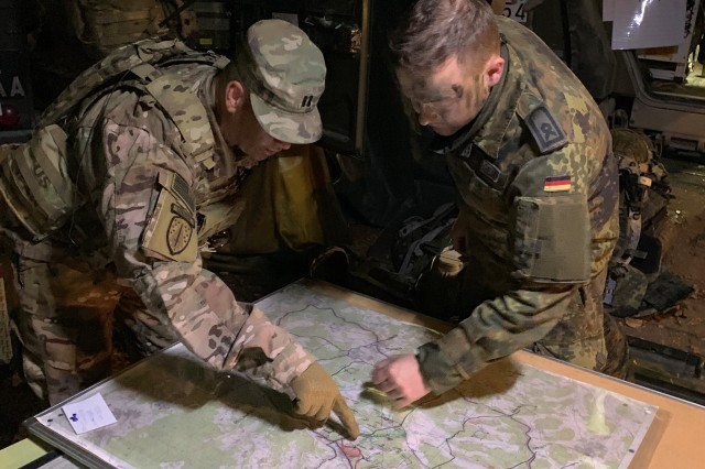 U.S. Army Capt. Steven Byrd, engineer advisor, Bravo Company, 5th Battalion, discusses obstacle emplacement plans with the Engineer Liaison from Germany's 2nd Brigade, 130th Armored Division during Allied Spirit X, an exercise which included approximately 5,630 participants from 15 nations at the 7th Army Training Command's Hohenfels Training Area from March 30 to April 17, 2019.