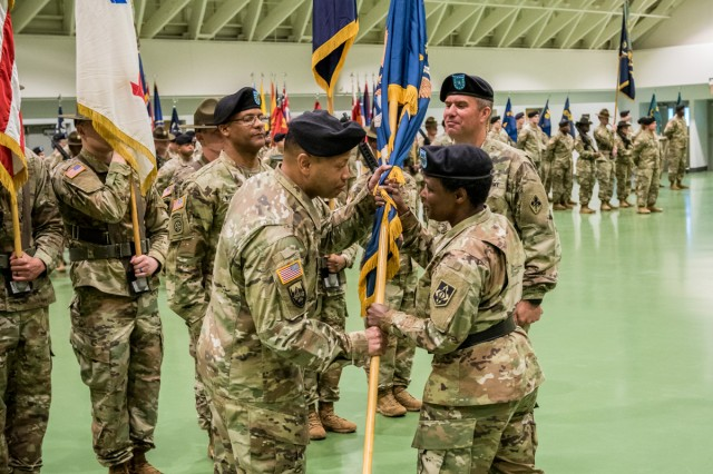 Maj. Gen. Donna Martin, MSCoE and Fort Leonard Wood commanding general, passes the colors to Col. Daryl Hood, USACBRNS commandant, during a Change of Commandant Ceremony held April 19 in Nutter Field House.