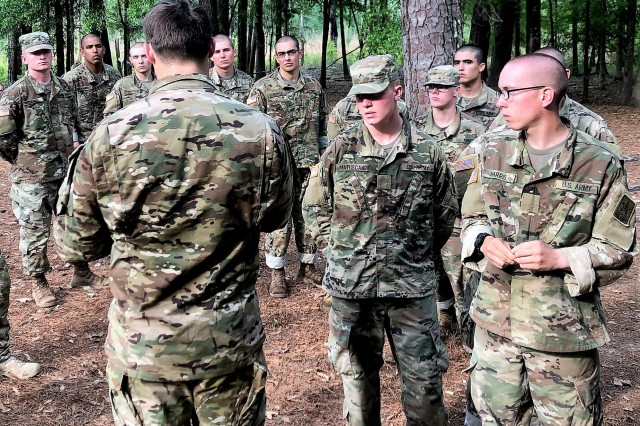 A U.S. Army Ranger from 3rd Battalion, 75th Ranger Regiment speaks with Soldiers-in-training following a 12-mile ruck march at infantry One-Station Unit Training (OSUT), Fort Benning, Ga., April 18, 2019. In collaboration with OSUT leadership and the Ranger Recruiting Liaison office, the Rangers are joining OSUT field exercises and fitness events to introduce trainees to the Ranger ethos, build camaraderie and answer questions about the Regiment. Following infantry OSUT, select trainees are on path to attend the Ranger Assessment and Selection Program and vie for an opportunity to join the Ranger Regiment.