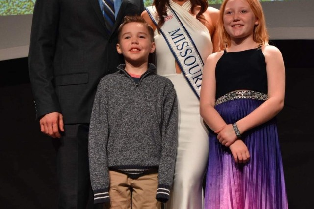 Chelsea George stands with her husband, Capt. Tony George, and children, Rowen and Riley, after being crowned Mrs. Missouri 2019.