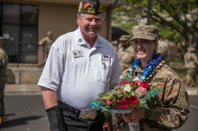 Joseph Bragg, a Veterans of Foreign Wars member, welcomes home the Soldiers from the 524th Combat Sustainment Support Battalion, April 30, 2019 at Schofield Barracks, Hawaii during a redeployment ceremony celebrating the successful completion of a 9-month combat tour in support of Operations Spartan Shield, Inherent Resolve, and Freedoms Sentinel. The Soldiers provided multi-class supply, retrograde operations, liquid logistics, aerial delivery, and general sustainment support throughout the U.S. Central Command area of responsibility. (U.S. Army Photo by Sgt. Sarah D Williams)